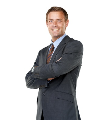 A young executive crossing his arms confidently while isolated on a white background